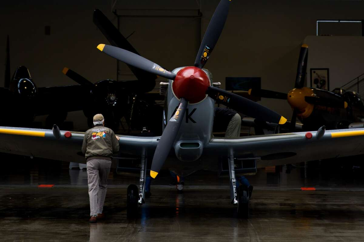 The WWII Vickers Supermarine Spitfire is put back into the hangar following a canceled test flight due to weather, at the Historic Flight Foundation in Mukilteo on Saturday, Jan. 16, 2016. AVickers Supermarine Spitfire used during World War II took shape at the Historic Flight Foundation in Mukilteo at the Paine Field Airport. A team of English airplane mechanics rebuilt the plane after it was shipped back following a tour of historic airshows in Europe. The HFF brought the team, their tools and the plane into the hangar. The plane was rebuilt in a span of one week. The Spitfire was originally used in the Czech squadron of the Royal Air Force and piloted by famous Flight Lieutenant Karel Posta.