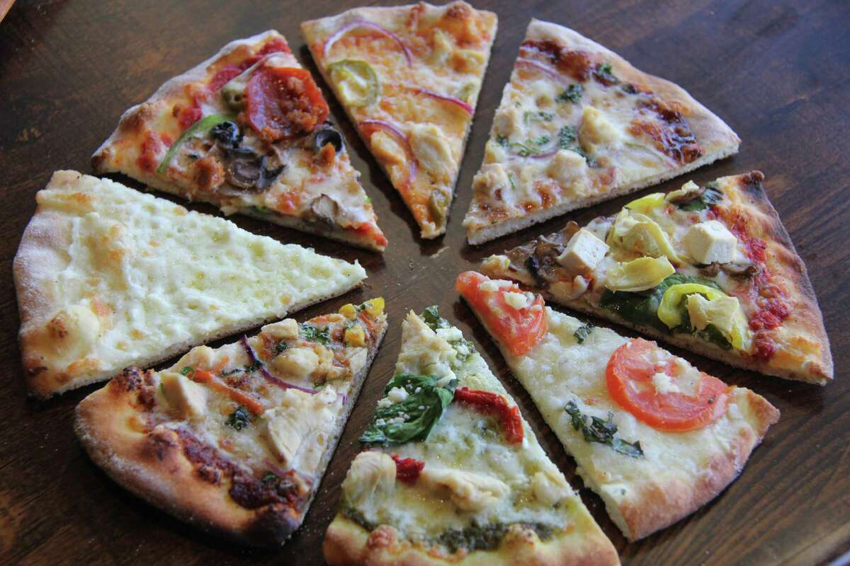 Your Pie customers build their pizzas by selecting from among 35 toppings. It gets baked for 3 to 4 minutes in a brick oven.