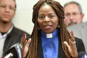 Rev. Valerie Faust of Living Word Tabernackle, center, speaks during a news conference on Wednesday, Jan. 20, 2016, at Union Missionary Baptist Church in Albany, N.Y. Community Leaders, local organizations and parents called on the Albany City School District Board of Education to renew its contract with Superintendent Marguerite Vanden Wyngaard, which is set to expire in June. (Cindy Schultz / Times Union)