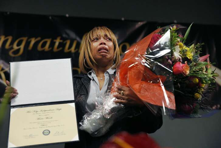 Gwendolyn Woods, the mother of the late Mario Woods who was fatally shot by San Francisco Police, sheds tears as she stands in front of a group of cameras after accepting a diploma for her son during the San Francisco Sheriff's Department's 5 Keys Charter Schools and Programs Community Graduation ceremony Jan. 20, 2015 in San Francisco, Calif.