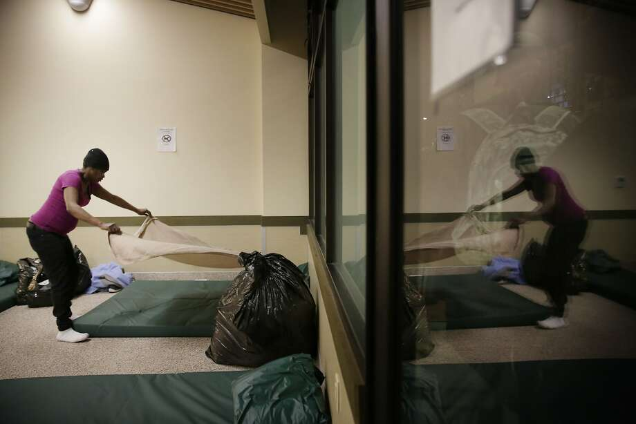 Dolores Mays, homeless client, makes up her bed at the St. Anthony's emergency winter shelter on Tuesday, January 19, 2016 in San Francisco, Calif. Mays said she had been sleeping in cubby's and places on the street and that she would still be sleeping there if it hadn't been for the getting the bed at St. Anthony's emergency winter shelter. Photo: Lea Suzuki, The Chronicle