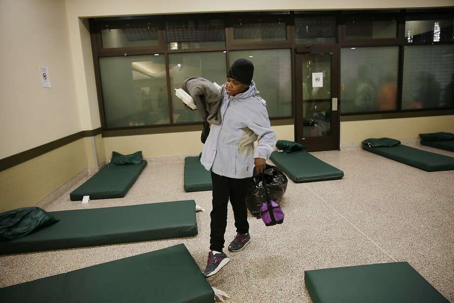 Dolores Mays, homeless client, carries her belongings as she selects a bed at the St. Anthony's emergency winter shelter as it opens in the evening for clients on Tuesday, January 19, 2016 in San Francisco, Calif. May said she had been sleeping in cubby's and places on the street and that she would still be sleeping there if it hadn't been for the getting the bed at St. Anthony's emergency winter shelter. Photo: Lea Suzuki, The Chronicle