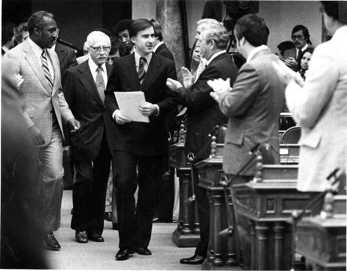 Gov. Jerry Brown receives applause from state lawmakers as he prepares to deliver his first State of the State speech in January 1976.