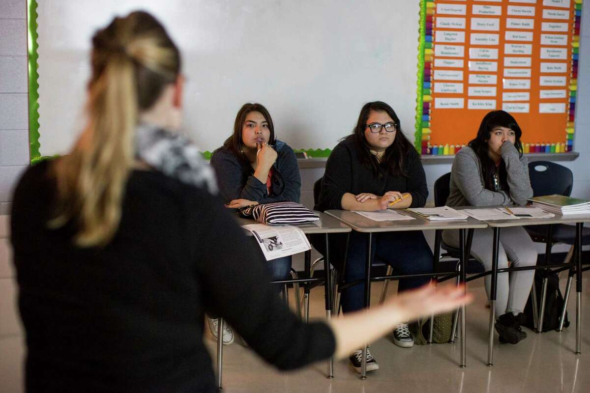 Tejeda Academy teacher Cari Barta (from left) offers instruction for her U.S. history students, including tenth-graders Jazmin Dillard, Ashliegh Hernandez and Rose Martinez. Tejeda Academy is one of the area schools whose students spend less than the now-required 75,600 minutes in attendance.