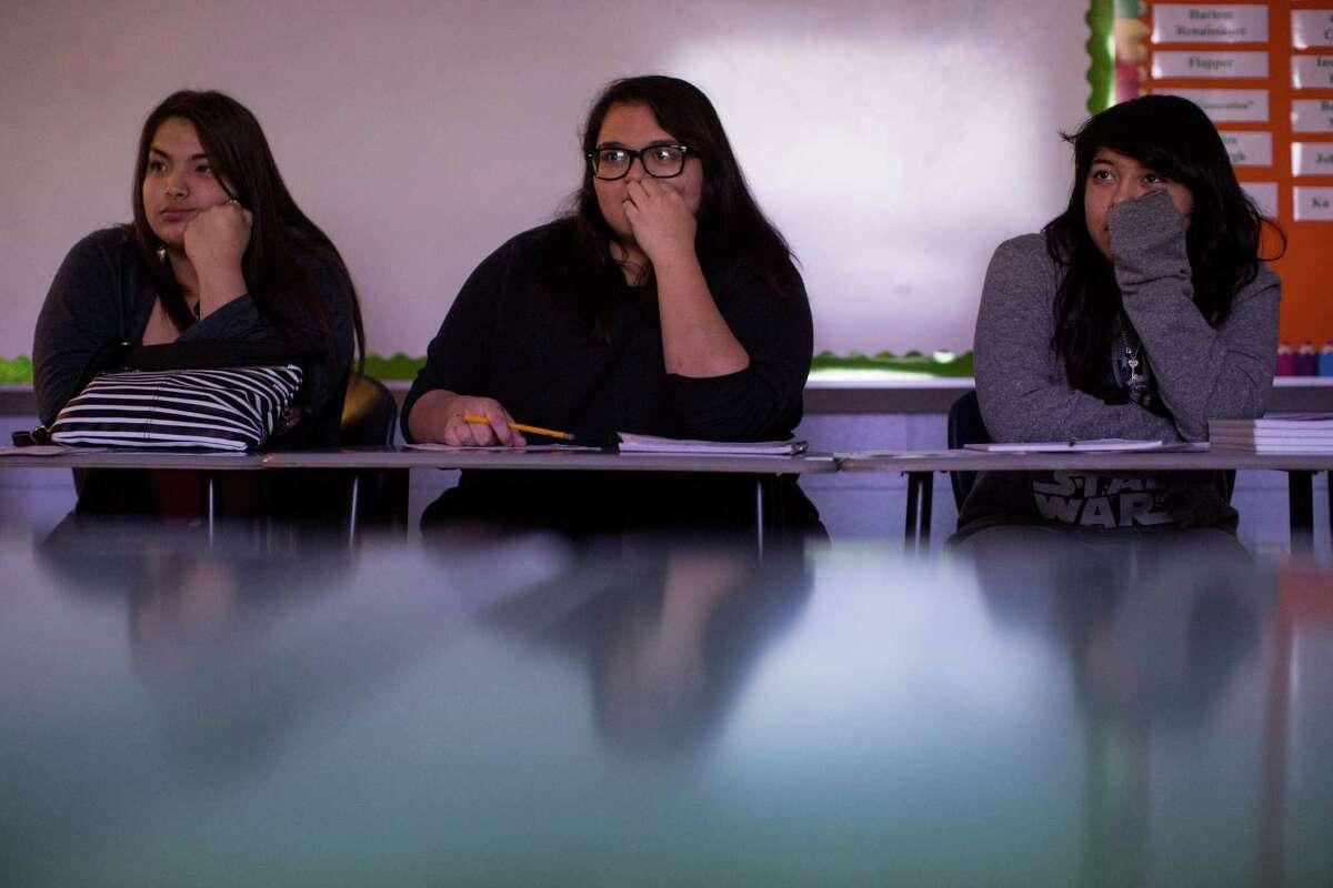 Tenth graders Jazmin Dillard, left, Ashliegh Hernandez and Rose Martinez listen in Cari Barta's U.S. history class at Tejeda Academy in San Antonio, Texas on January 20, 2016.