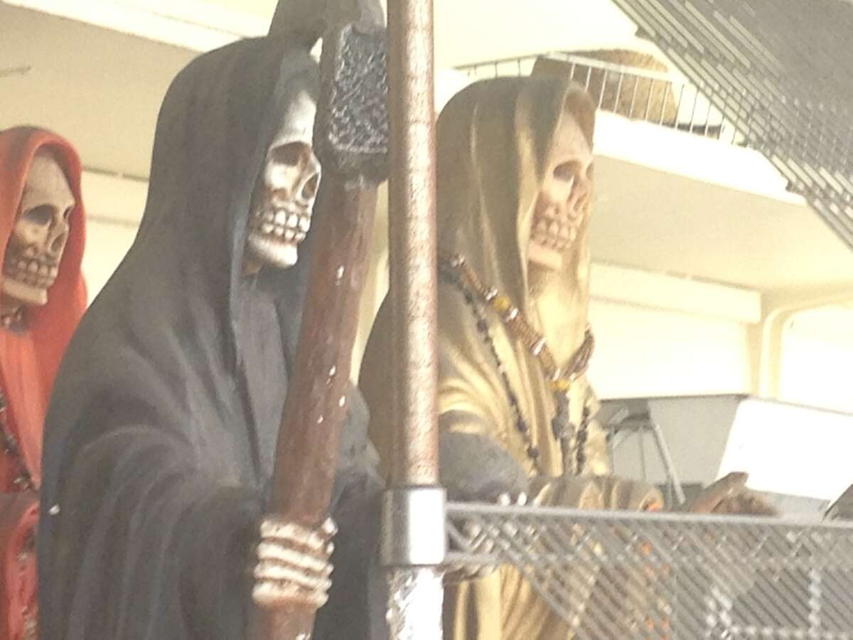 Santa Muerte is a cult religious figure you'll find in many areas of Houston. Keep clicking to see more images of a shrine in the Heights.