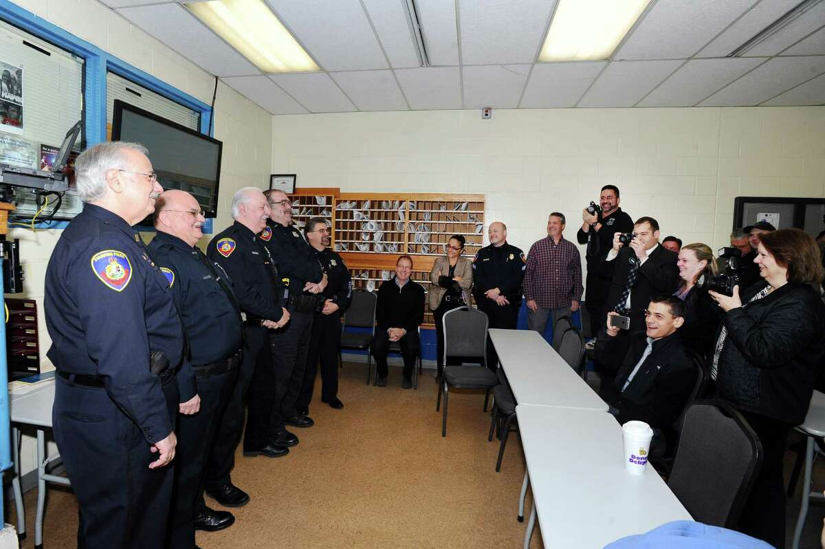 The Stamford police officers who received shields one through five pose for pictures inside the Stamford Police Station Headquarters on Jan. 20, 2016.