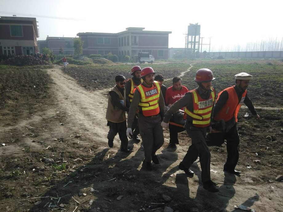 Rescuers move an injured victim outside the Bacha Khan university following an attack by gunmen in Charsadda, about 20 miles from Peshawar, on Wednesday. Photo: A MAJEED, Stringer / AFP