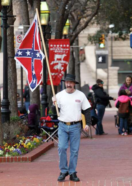 A man carries a Confederate battle flag in Fort Worth on Saturday, Jan. 16, 2016 during the Fort Worth Stock Show All Western Parade. (Paul Moseley/Star-Telegram via AP) Photo: Paul Moseley, MBI / Star-Telegram