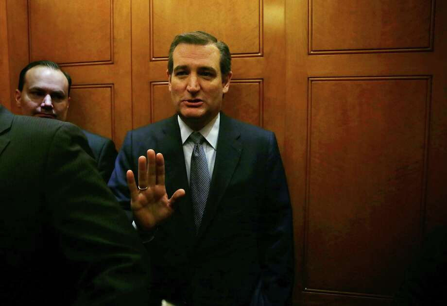 Republican presidential candidate Sen. Ted Cruz, R-Texas, refuses to answer questions from the media as he leaves with Sen. Mike Lee, R-Utah, after a vote Jan. 20, 2016 on Capitol Hill in Washington, D.C. The Senate failed to advance a bill that requires more screening for taking in refugees from Iraq and Syria.  (Photo by Alex Wong/Getty Images) Photo: Alex Wong, Staff / 2016 Getty Images