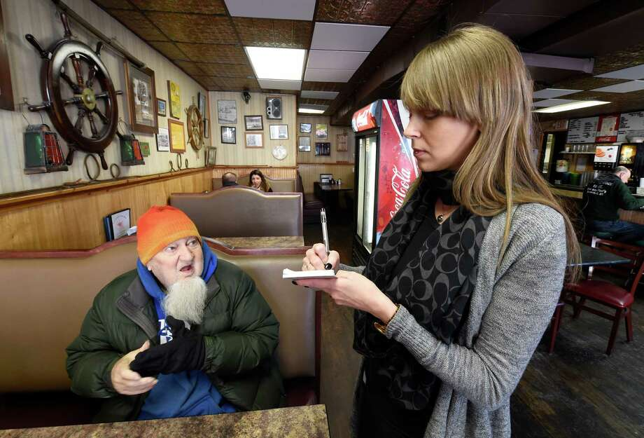 Annie Thomas, right, takes the order of Bill Cox at the Don and Paul's Coffee Shop Wednesday morning, Jan. 20, 2016, in Waterford, N.Y. The coffee shop has remained open even with the water emergency. (Skip Dickstein/Times Union) Photo: SKIP DICKSTEIN / 10035076A