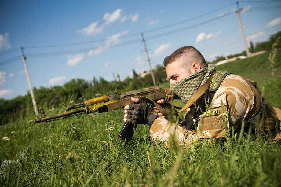 A Seattle-area arms importer has sued the federal government claiming the ATF has unfairly restricted importation of ammunition developed for the AK-74 assault rifle, pictured above in the hands of a fighter in Ukraine.