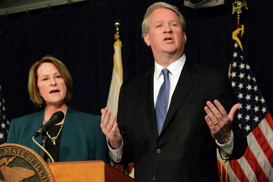 Illinois House Republican Leader Jim Durkin, right, and Senate GOP Leader Christine Radogno speak at a news conference in Chicago, Wednesday, Jan. 20, 2016, where they called for a state takeover of the financially troubled Chicago Public Schools. They said the proposed legislation would give the Illinois State Board of Education control over the nation's third-largest school district. (Brian Jackson/Chicago Sun-Times via AP) CHICAGO TRIBUNE OUT, MANDATORY CREDIT, MAGS OUT, NO SALES Photo: Brian Jackson, MBR / Chicago Sun-Times