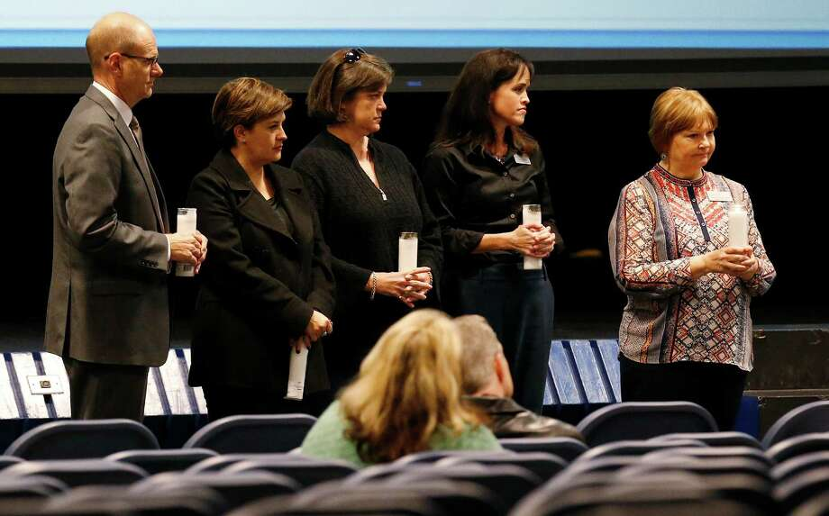 Officials from Children's Bereavement Center of South Texas along with Alamo Heights Independent School District gather with concerned parents and citizens to discuss how young people grieve in the wake of a suicide by Alamo Heights High School student David Molak at the district's Junior School on Wednesday, Jan. 20, 2016. About 35 people gathered to hear how adults should understand and cope with a child's grieving process. Officials including a parent held symbolically-lit candles to conclude the discussion. Holding the candles are (from right to left): Children's Bereavement Center's Tami Logsdon, Leslie Wood, parent Debbie Chesney, AHISD Wellness Coordinator Michelli Ramon and AHISD Superintendent Kevin Brown. Photo: Kin Man Hui /San Antonio Express-News / ©2016 San Antonio Express-News