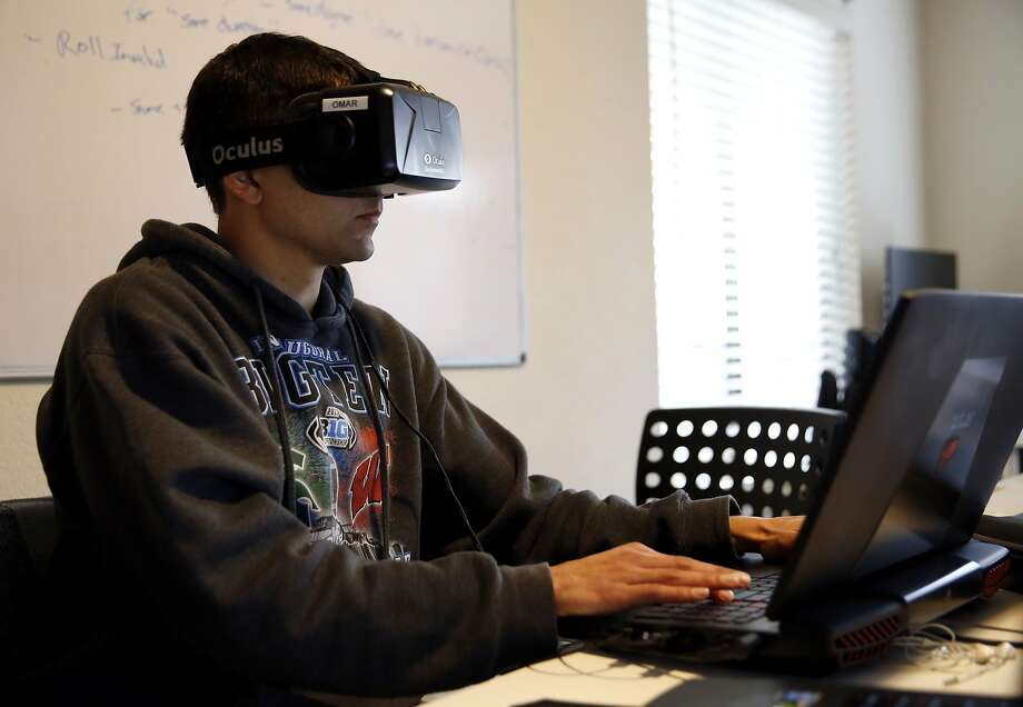 Omar Ahmad works while wearing an Oculus device at STRIVR headquarters in Menlo Park, California, on Wednesday, Jan. 20, 2016. Photo: Connor Radnovich, The Chronicle