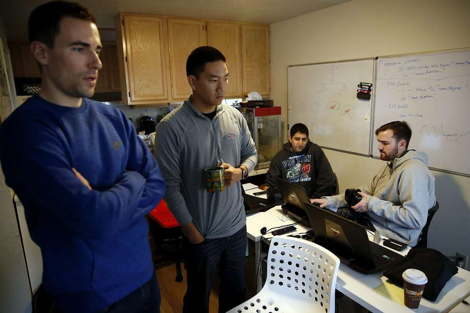 Andrew Wasserman (left) and Edward Park watch a virtual reality demonstration while Omar Ahmad and Jordan Kutzer work on a laptop at STRIVR headquarters in Menlo Park, California, on Wednesday, Jan. 20, 2016. Photo: Connor Radnovich, The Chronicle