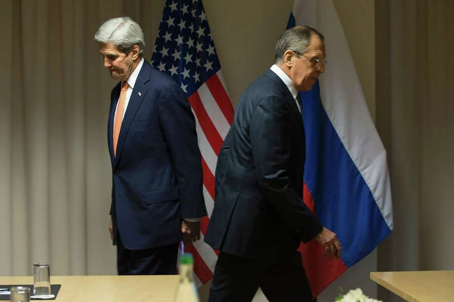 U.S. Secretary of State John Kerry, left, and Russian Foreign Minister Sergey Lavrov arrive in Zurich on Wednesday for talks on the Syria peace process. Peace talks are scheduled to begin Monday, but there have been disagreements on which delegates will have a seat at the talks. Photo: JACQUELYN MARTIN, Stringer / AFP
