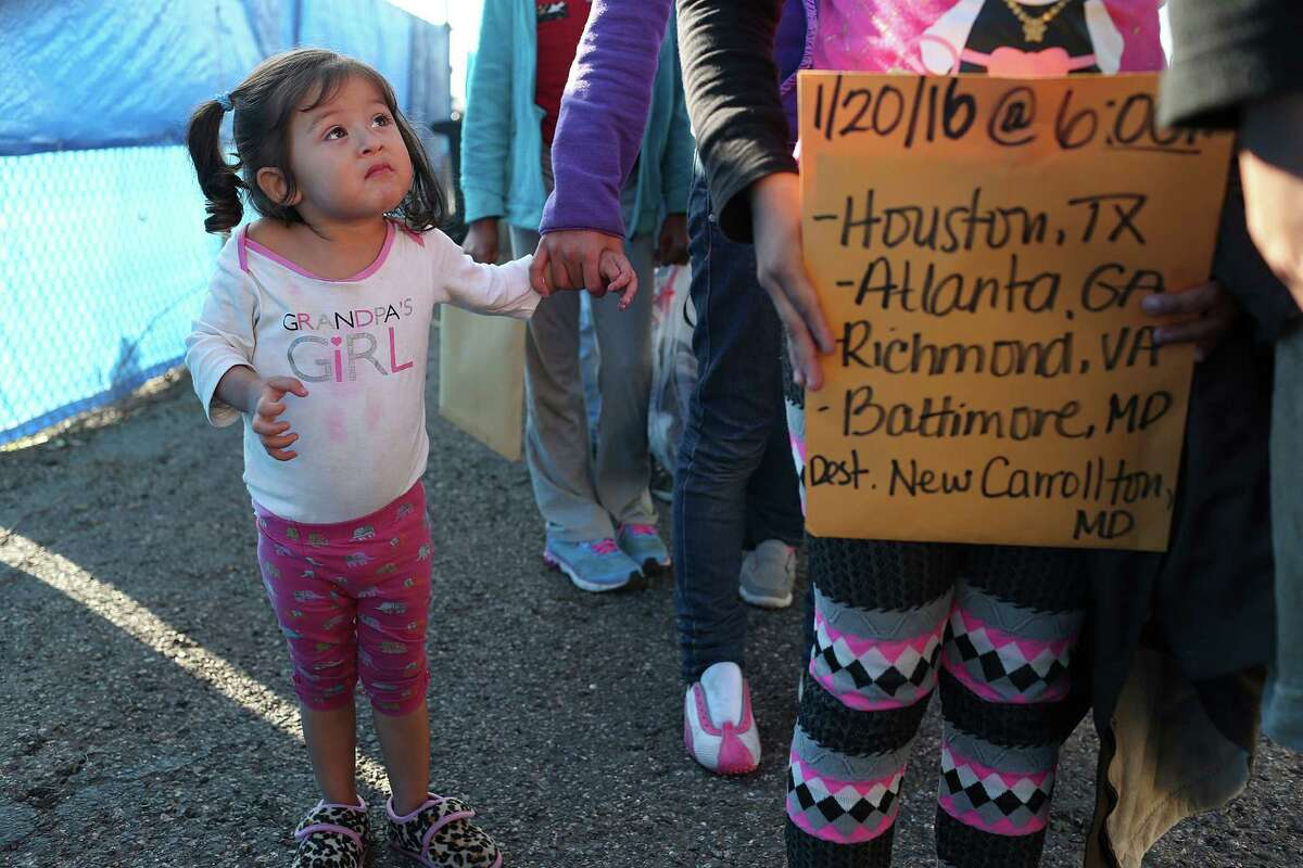 Two-year-old Sherley Fuentes is held firmly by her mother as mostly Central American immigrant families arrive at the Sacred Heart Catholic Church immigrant shelter in McAllen, Texas, Tuesday, Jan. 19, 2016. The Honduran mother and daughter were traveling to Dallas, Texas after being released by U.S. immigrations officials.