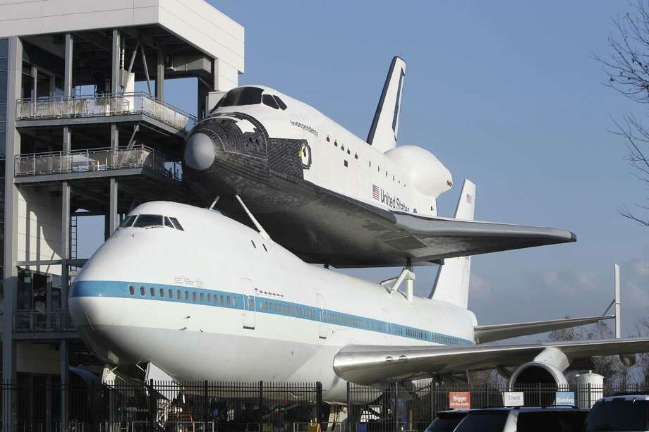 Space Center Houston's new exhibit, which opens Saturday, features a replica of the space shuttle perched atop one of the two Boeing 747s used to transport the shuttles. Photo: Steve Gonzales / © 2016 Houston Chronicle