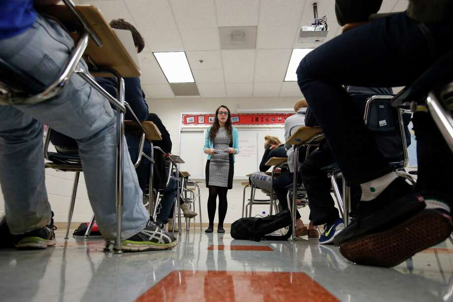 In this photo taken Jan. 17, 2016, Katerina Maylock, with Capitals Educators, teaches a college test preparation class at Holton Arms School in Bethesda.  Photo: Alex Brandon / AP
