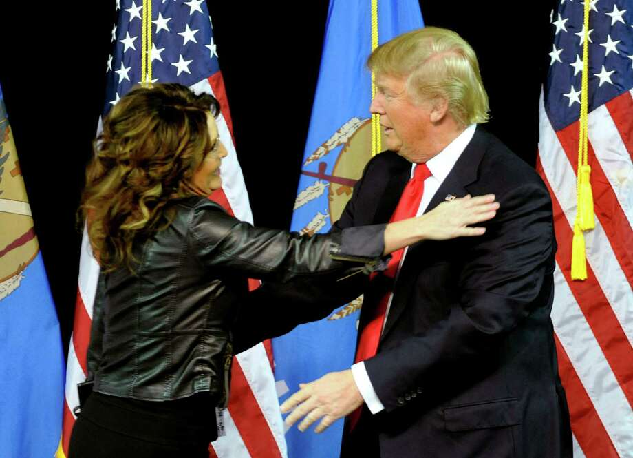 Former Republican vice-presidential nominee Sarah Palin hugs Republican presidential candidate Donald Trump on Wednesday after she introduced him in Tulsa, Okla. Palin's endorsement gives Trump tea-party credibility and highlights the anti-establishment insurgency within the GOP. Photo: Brandi Simons, FRE / FR29032 AP
