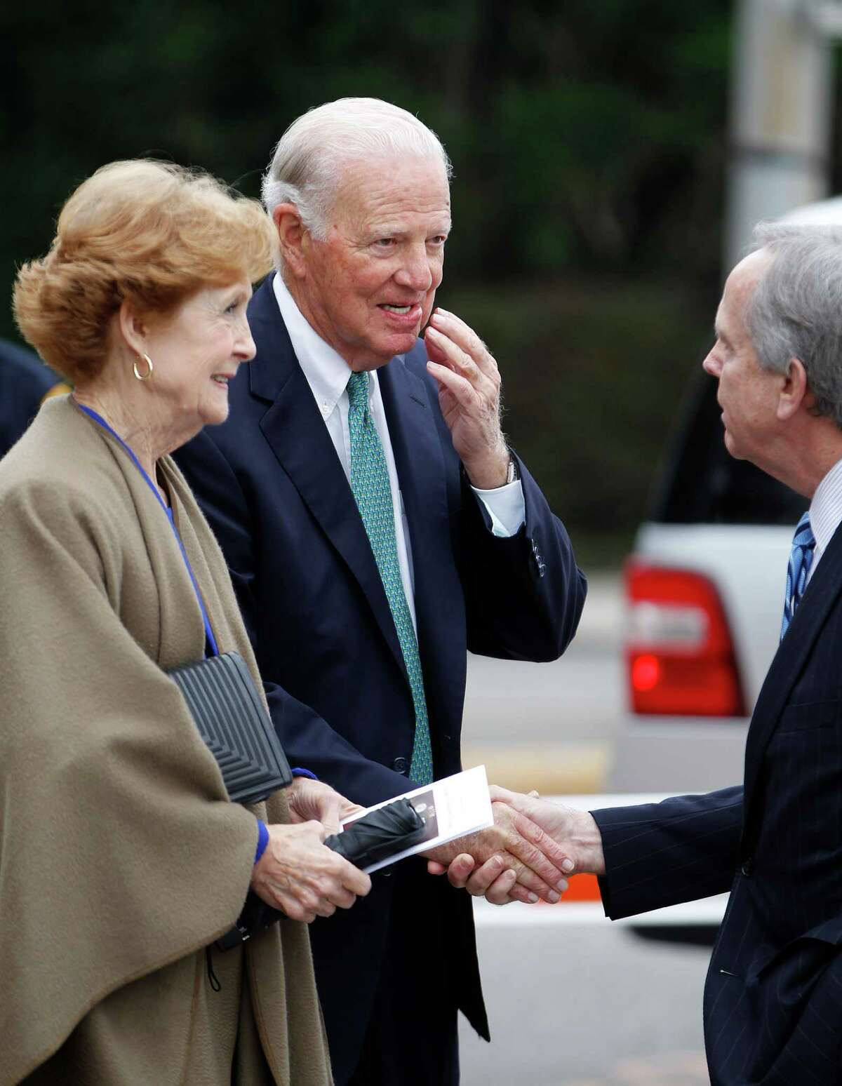 James and Susan Baker are greeted by David Jones during an invitation-only ceremony officially renaming the Preston Street Bridge near downtown in late Robert A. Mosbacher, Sr.'s honor on Wednesday, Jan. 20, 2016, in Houston. The event was attended by Former President and Mrs George H. W. Bush and former Secretary of State and Mrs. James A. Baker, III will join the family, friends and former colleagues of the late Robert A. Mosbacher, Sr.