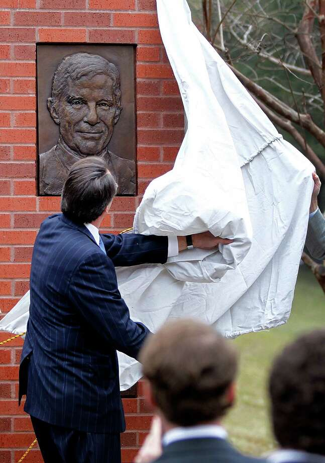 Robert Mosbacher, Jr. pulls a sheet off of one of the plaques during an invitation-only ceremony officially renaming the Preston Street Bridge near downtown in late Robert A. Mosbacher, Sr.'s honor on Wednesday, Jan. 20, 2016, in Houston. The event was attended by  Former President and Mrs George H. W. Bush and former Secretary of State and Mrs. James A. Baker, III will join the family, friends and former colleagues of the late Robert A. Mosbacher, Sr. Photo: Karen Warren, Houston Chronicle / © 2015  Houston Chronicle