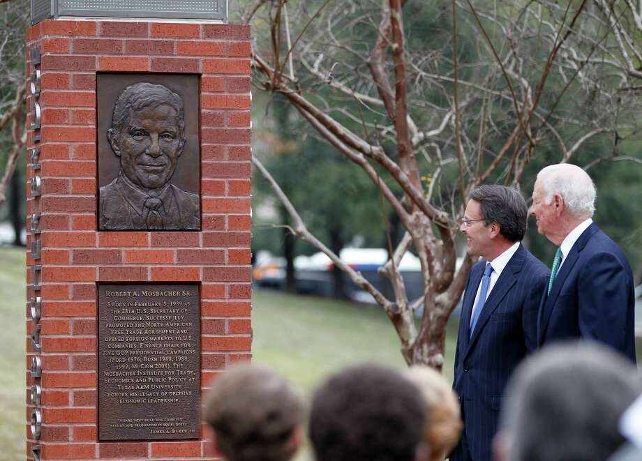Robert Mosbacher, Jr. and James Baker look up at a plaque during an invitation-only ceremony officially renaming the Preston Street Bridge near downtown in late Robert A. Mosbacher, Sr.'s honor on Wednesday, Jan. 20, 2016, in Houston. The event was attended by  Former President and Mrs George H. W. Bush and former Secretary of State and Mrs. James A. Baker, III will join the family, friends and former colleagues of the late Robert A. Mosbacher, Sr. ( Karen Warren / Houston Chronicle ) Photo: Karen Warren, Staff / © 2015  Houston Chronicle