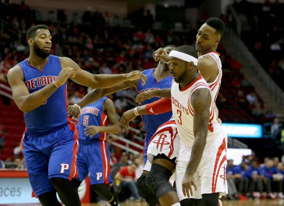 Houston Rockets center Dwight Howard (12) is injured while running into Houston Rockets guard Ty Lawson (3) and Detroit Pistons forward Stanley Johnson (3) during the first quarter at the Toyota Center Wednesday, Jan. 20, 2016, in Houston. ( Gary Coronado / Houston Chronicle ) Photo: Gary Coronado, Houston Chronicle
