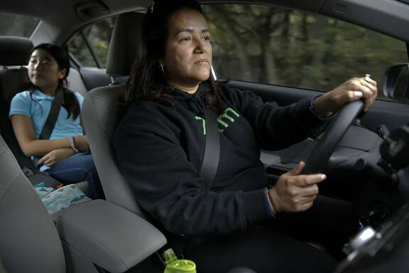 Zum driver Marcia Bravo drives seventh grade student Ellie Chang to her San Mateo home after being picked up from school in Portola Valley, Calif., on Wed. January 20, 2016.  Zum, which has childcare providers giving rides to kids are also be available to watch them in their homes.