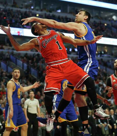 The  Warriors' Andrew Bogut fouls the Bulls' Derrick Rose but fails to prevent Rose from making the shot. Photo: Nuccio DiNuzzo, MBR / Chicago Tribune
