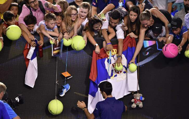 Everybody wants a piece of Novak Djokovic at the Australian Open, from fans requesting autographs after his second-round win to reporters keeping a match-fixing controversy alive.