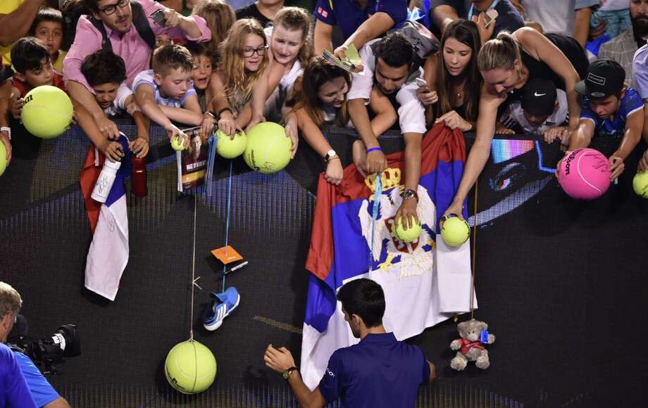 Everybody wants a piece of Novak Djokovic at the Australian Open, from fans requesting autographs after his second-round win to reporters keeping a match-fixing controversy alive. Photo: PETER PARKS, Staff / AFP