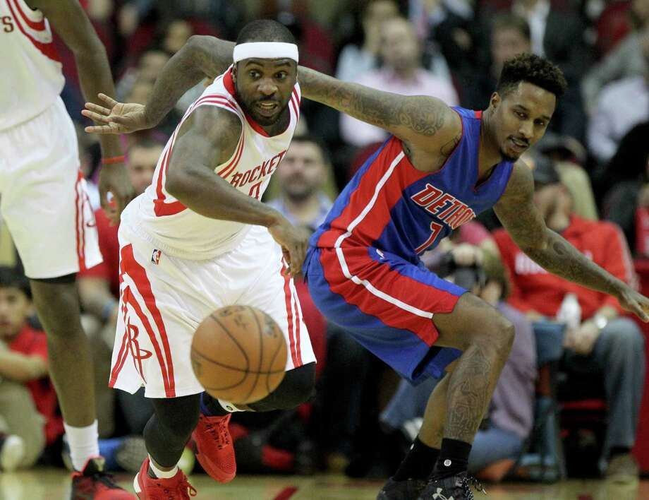 Rockets guard Ty Lawson, left, takes off after picking the pocket of the Pistons' Reggie Jackson. Photo: Gary Coronado, Staff / © 2015 Houston Chronicle