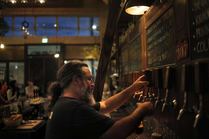 Dave McLean, owner of Magnolia Brewing Company, pours a glass of Shmaltz beer during a benefit for the Institute for Myeloma and Bone Cancer Research at the Magnolia Brewing Company in San Francisco, Calif., on Wednesday, January 20, 2016.