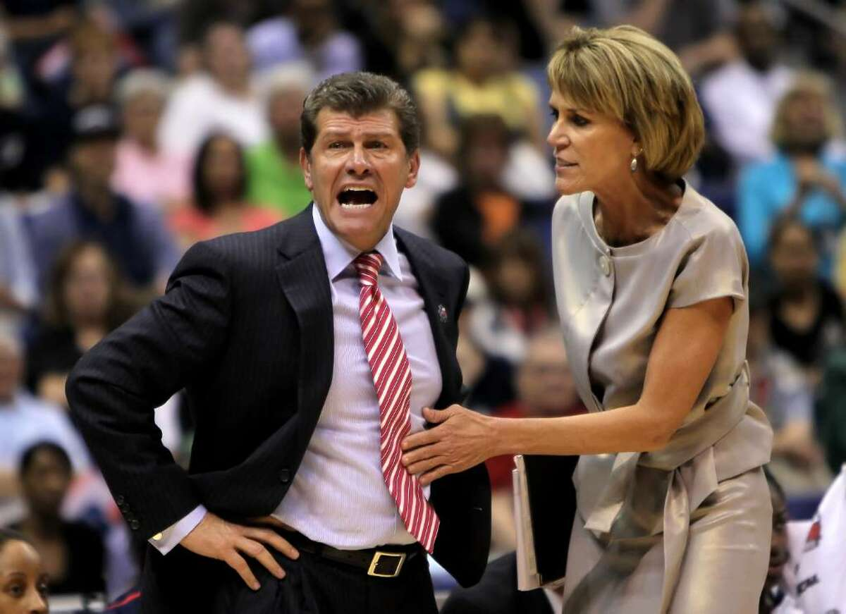 SAN ANTONIO - APRIL 04: Connecticut Huskies head coach Geno Auriemma is restrained by associate coach Chris Dailey in the second half against the Baylor Bears during the Women's Final Four Semifinals at the Alamodome on April 4, 2010 in San Antonio, Texas. Connecticut defeated Baylor 70-50. (Photo by Jeff Gross/Getty Images) *** Local Caption *** Geno Auriemma;Chris Dailey