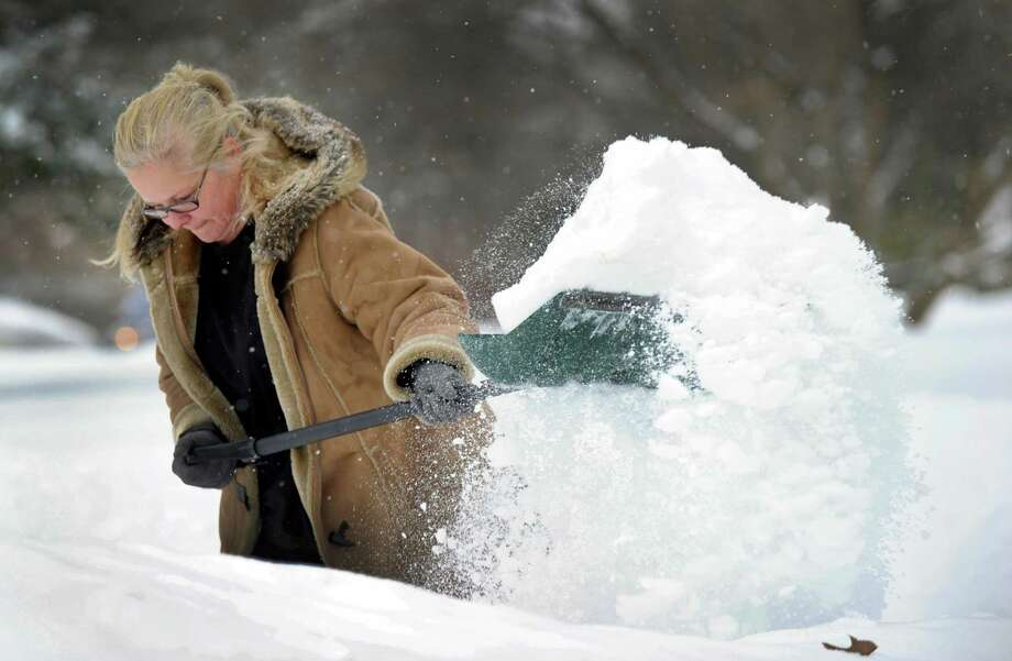 Anda McGowan shovels the snow in her driveway on Candlewood Lake Road in New Milford, Conn., Monday, February 9, 2015. Photo: Carol Kaliff / Carol Kaliff / The News-Times