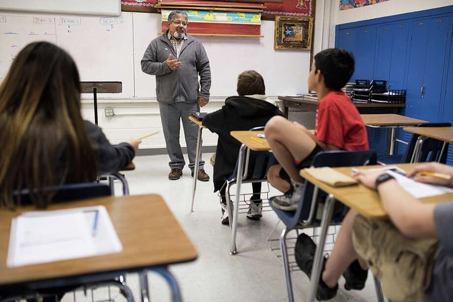 Ramon Cavazos teaches a middle school business class in the Olfen Independent School District in Rowena, Texas, on Jan. 20, 2016.  Photo: Cooper Neil
