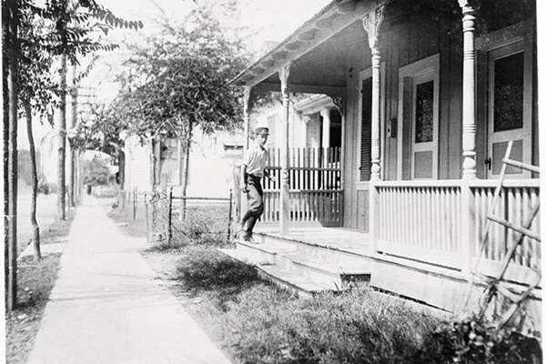 "Sixteen year old messenger boy entering ""crib"" in Red Light district. Location: San Antonio, Texas."