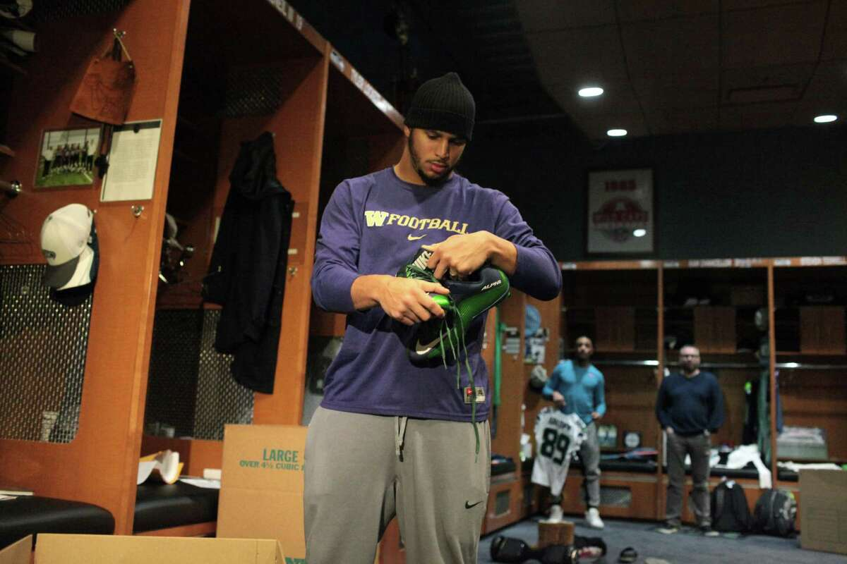 Seattle Seahawks wide receiver Jermaine Kearse packs up his cleats in the team locker room, Monday, Jan. 18, 2016, in Renton, Wash. The Seahawks' season ended Sunday, Jan. 17, 2016, with a loss to the Carolina Panthers in an NFL football divisional playoff game.