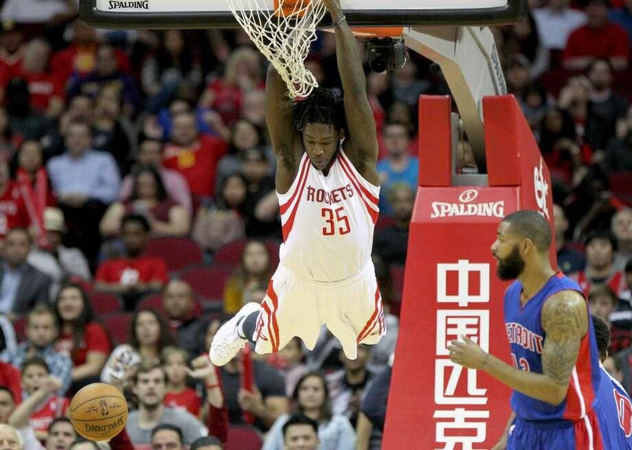 Houston Rockets forward Montrezl Harrell (35) slam dunks the ball against the Detroit Pistons during the fourth quarter at the Toyota Center Wednesday, Jan. 20, 2016, in Houston. Rockets lost 114-123. ( Gary Coronado / Houston Chronicle ) Photo: Houston Chronicle