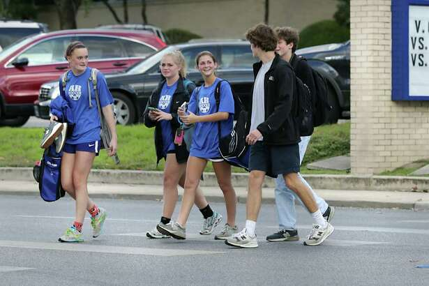 Students from Alamo Heights High School, where student David Molak had been bullied, walk across Broadway after the final bell rang on Thursday, Jan. 14, 2015.