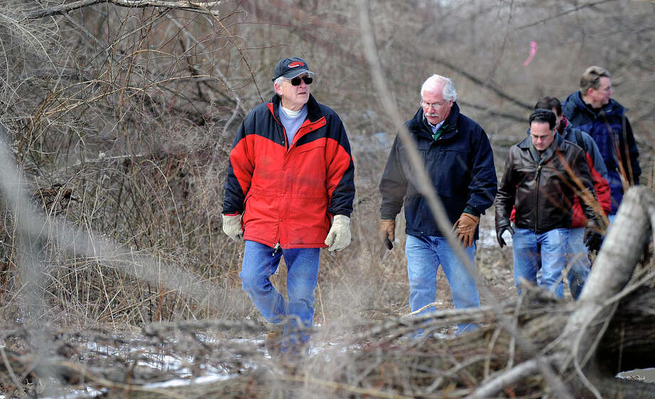 Members of the Danbury Enviornmental Impact Commission, representatives of the developer and people from the neighborhood took a site walk of the Cotswald property near Padanaram Road in 2013. Photo: / Carol Kaliff / The News-Times
