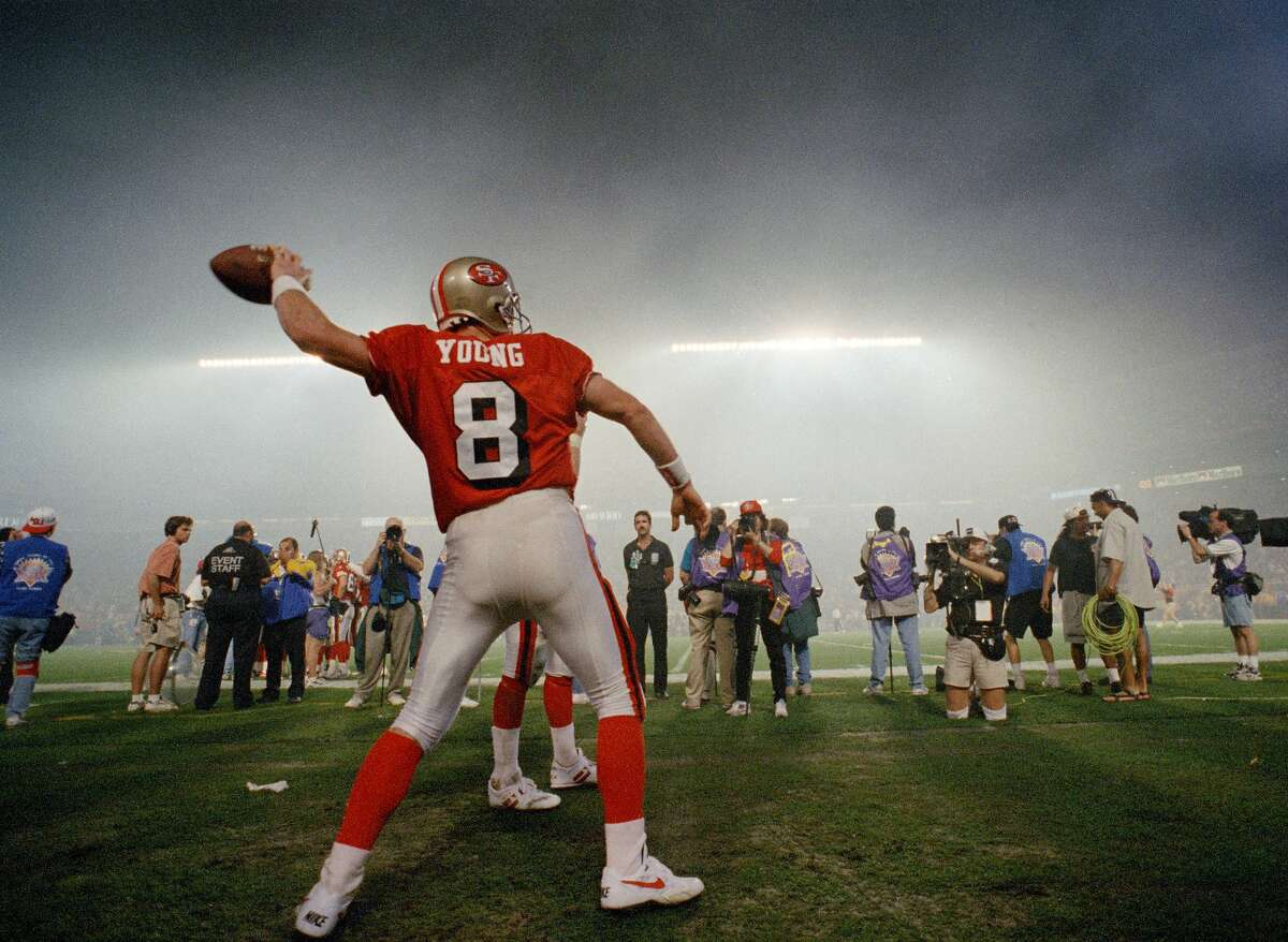 San Francisco 49ers quarterback Steve Young warms up for the second half against the San Diego Chargers following a smoky Indiana Jones-themed halftime show at Super Bowl XXIX in Miami, Jan. 29, 1995.