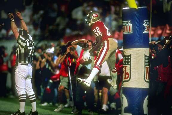 22 Jan 1989:  Wide receiver John Taylor of the San Francisco 49ers scores a touchdown during Super Bowl XXIII against the Cincinnati Bengals at Joe Robbie Stadium in Miami, Florida.  The 49ers won the game, 20-16. Mandatory Credit: Mike Powell  /Allsport