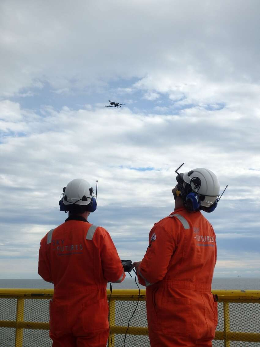 Sky Futures pilots operate a drone on the deck of an oil platform in the Gulf of Mexico in September 2015. (Sky Futures)