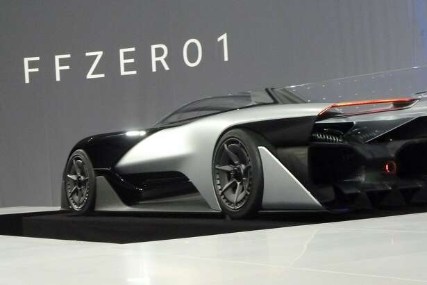 The new concept electric car FFZERO is unveiled by California startup Faraday Future during the Consumer Electronics Show (CES) on January 4, 2016 in Las Vegas, Nevada.   Faraday Future is seeking to redefine mobility with a new line of electric vehicles.     AFP PHOTO / ROB LEVERRob LEVER/AFP/Getty Images