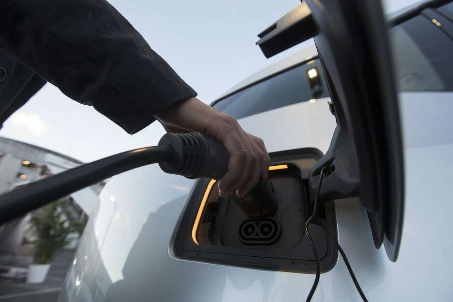 An electric car is plugged into a charging station. While many U.S. consumers have shown little interest in electric vehicles, Californians have been an exception.By the end of last year, the state had about 270,000 electric cars and plug-in hybrids on its roads. Photo: David Mcnew, AFP / Getty Images