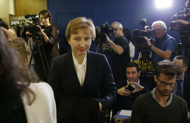 """Marina Litvinenko, widow of former Russian spy Alexander Litvinenko, arrives for a press conference in London, Thursday, Jan. 21, 2016. Judge Robert Owen said Thursday he is certain that Litvinenko was given tea laced with a fatal dose of polonium-210 at a London hotel in November 2006. He says there is a """"strong probability"""" that the FSB directed the killing and the operation was """"probably approved"""" by Russian President Vladimir Putin."""