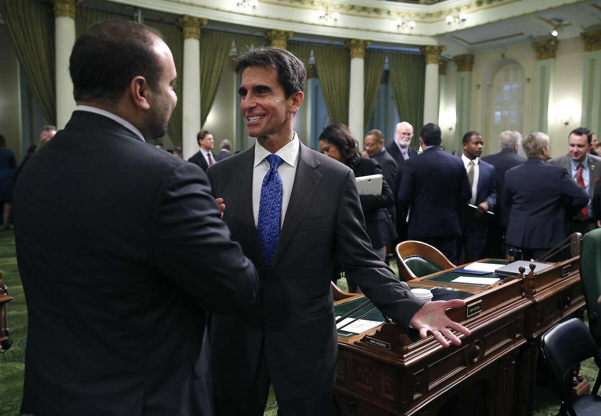 State Sen. Mark Leno meets with a colleague after Gov. Jerry Brown's State of the State address at the State Capitol in Sacramento, Calif. on Thursday, Jan. 21, 2016.